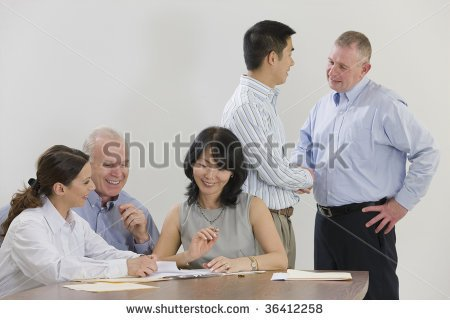 stock-photo-five-person-business-meeting-with-handshaking-36412258
